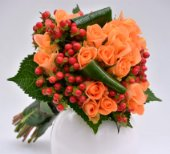 Bouquet with orange roses and berries