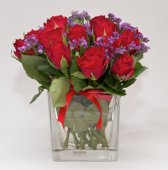 Glass with small red roses